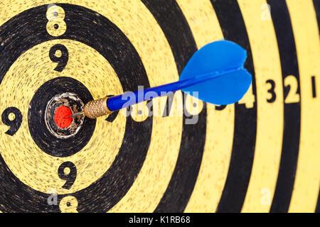 Lucky concept: photography success hitting target aim goal Blue Dart in bull's eye.  - Stock Photo