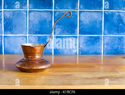 Copper coffee maker on the kitchen table - Stock Photo
