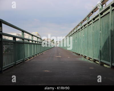 Very long Asphalt Footpath with Green Metal Banisters Perspective - Stock Photo