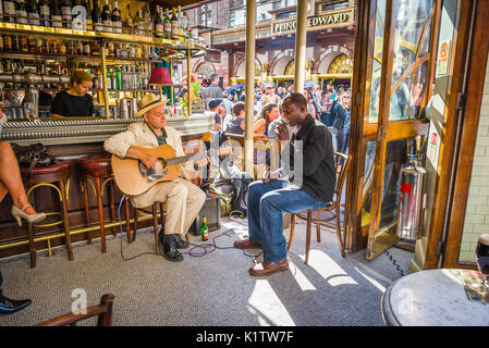Soho London pub, two blues musicians perform inside the Cafe Boheme in Old Compton Street on a summer afternoon, - Stock Photo