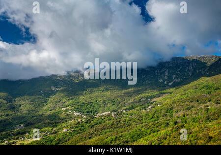 Monte Stello massif over village of Sisco, Cap Corse, Haute-Corse department, Corsica, France - Stock Photo