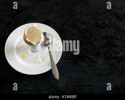 egg shells in an egg-cup  on black stone - Stock Photo