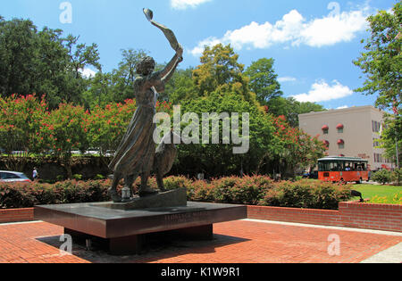 SAVANNAH, GA – JULY 22: A tribute to Florence Martus, the Waving Girl statue stands watch over the Savannah River - Stock Photo