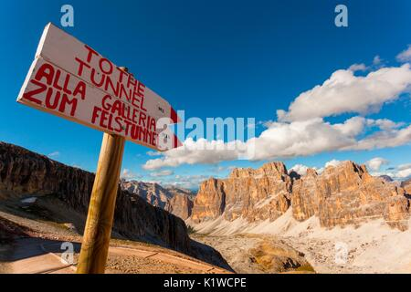 Sign with directions to get to the tunnel of war Lagazuoi, Dolomites. Today it is one of its kind, the longest among - Stock Photo