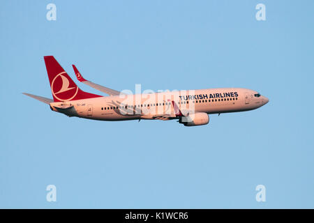 Boeing 737-800 passenger jet plane belonging to Turkish Airlines in flight on departure at sunset. Air travel and commercial flying.