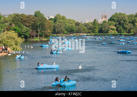 Hyde Park London, tourists enjoy a summer afternoon on the Serpentine Lake in Hyde Park, London, UK. - Stock Photo