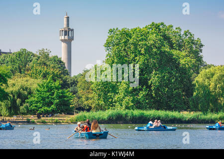 Regent's Park London, tourists in boats enjoy a summer afternoon on the boating lake in Regent's Park, London, UK. - Stock Photo