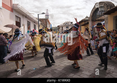 June 17, 2017 Pujili, Ecuador: traditional dancers performing at the Corpus Christi parade - Stock Photo