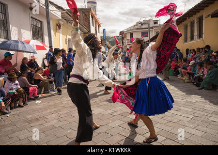 June 17, 2017 Pujili, Ecuador: street dancers performing in traditional clothing during Corpus Christi - Stock Photo