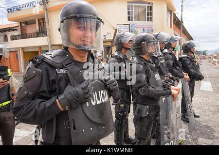 riot police in action in Cotacachi Imbabura Ecuador during inti raymi parade at summer solstice - Stock Photo