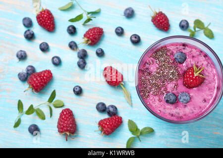 Smoothies with blueberries and raspberries, chia seeds in a glass cup. view from above - Stock Photo