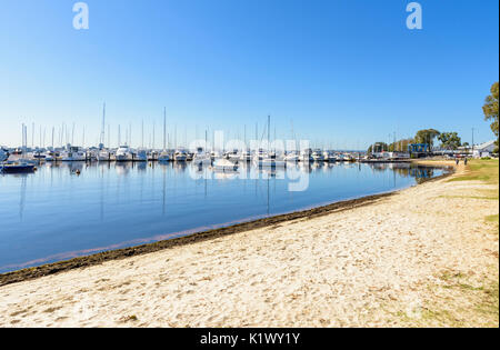 Boats moored at Royal Perth Yacht Club in Matilda Bay on the sandy foreshore of the Swan River, Crawley, Perth, - Stock Photo