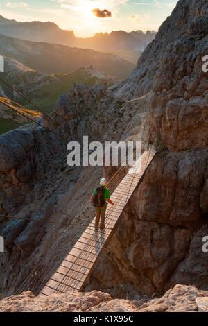 Walking the path of Kaiserjaeger you reach a secured walking section and a suspension bridge with steel cables 15 - Stock Photo