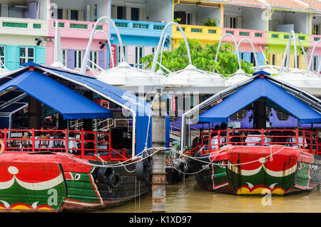 Colourful restaurant boats anchored at Clarke Quay, Singapore - Stock Photo