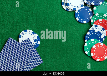 Casino green table with chips and play cards. Poker game concept - Stock Photo