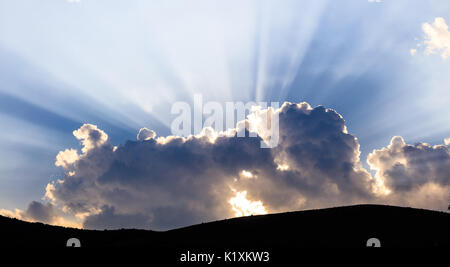 Cloudy sky over mountains silhouette in the evening - Stock Photo