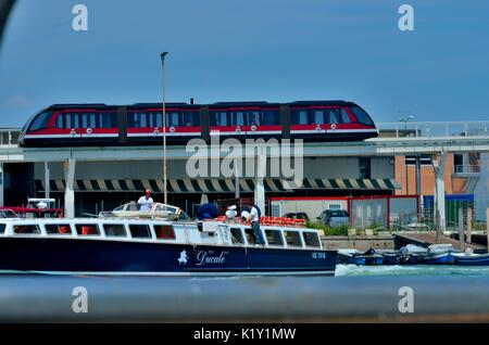 'People Mover'- Venice Monorail - Shuttle Service in action, below the monorail bridge is Ducale boat in action, - Stock Photo