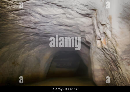 camera moves along wall of the cave and comes to a standstill - Stock Photo