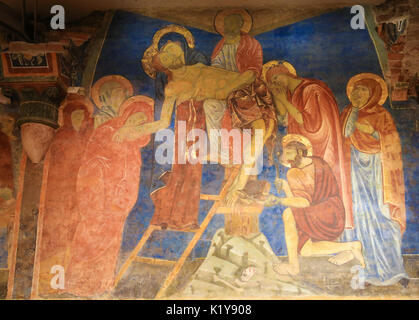 Fresco (1270) in the Crypt of Siena Cathedral in Siena, Tuscany, Italy, depicting Jesus taken from the Cross on - Stock Photo