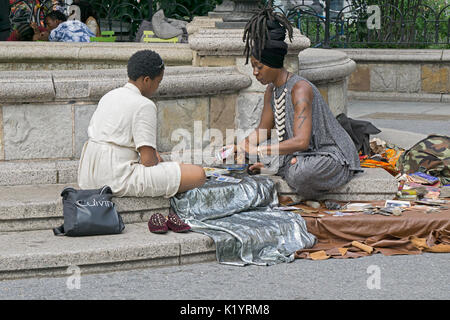 A tarot card reading in Union Square Park in New York City - Stock Photo
