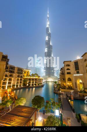 Burj Khalifa, artificial lake with lighted fountain, blue hour, Dubai, Emirate Dubai, United Arab Emirates - Stock Photo