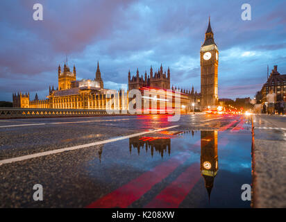 Light traces, double-deck bus, Westminster Bridge, Palace of Westminster, Houses of Parliament with reflection, - Stock Photo