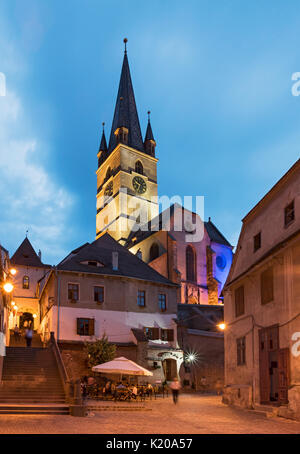 Old Town and Lutheran Cathedral by Night, Sibiu, Romania - Stock Photo