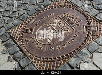 Manhole cover, Sibiu, Hermannstadt, Romania - Stock Photo