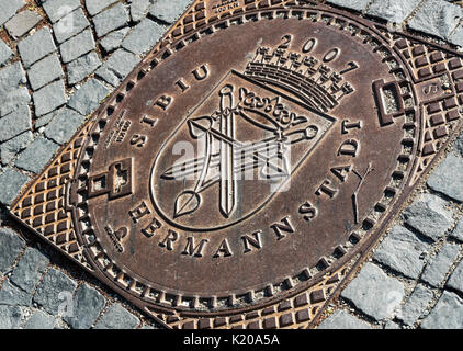 Manhole cover, Sibiu, Hermannstadt, Romania - Stock Photo