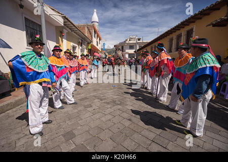 June 17, 2017 Pujili, Ecuador: indigenous quechua men in traditional wear during the Corpus Christi celebrations - Stock Photo