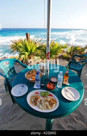 Mexican food on the table in Coconuts restaurant bar with beautiful view on the coast, Cozumel Island - Stock Photo