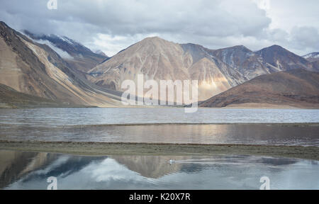 Reflection of Pangong Lake in Ladakh, India. Pangong is an endorheic lake in the Himalayas situated at a height - Stock Photo