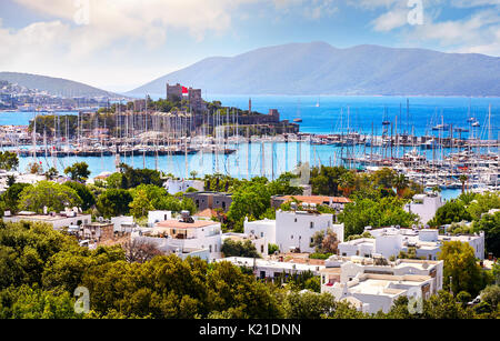 View of Bodrum castle and Marina Harbor in Aegean sea in Turkey - Stock Photo