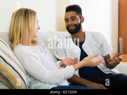 Portrait of happy spouses joking and smiling indoors - Stock Photo