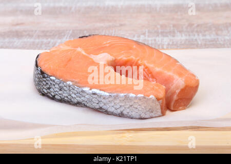 fresh raw salmon with spices on wooden cutting board. ready for cookin. - Stock Photo