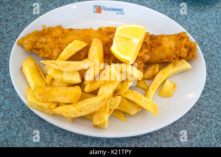 Excellent small Haddock and chips with lemon The Fisherman's Wife Cafe in Whitby - Stock Photo