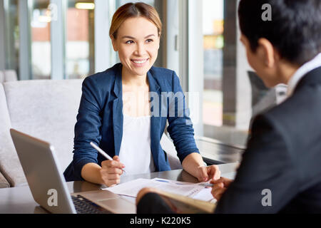 Productive Negotiations of Business Partners - Stock Photo