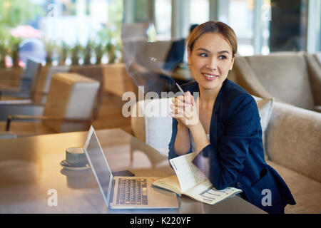 Asian Entrepreneur Working at Cafe - Stock Photo