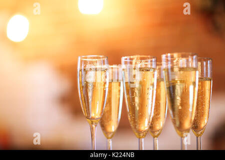 Champagne glasses on gold background. Party and holiday celebration concept - Stock Photo