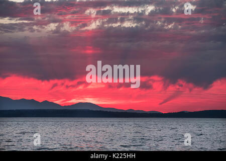 Sunset over Puget Sound and the Olympic Mountains, Washington State, USA - Stock Photo