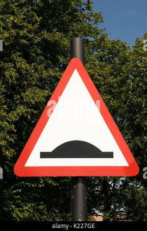 Bump warning traffic sign - Stock Photo