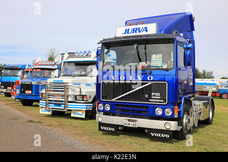 ALAHARMA, FINLAND - AUGUST 11, 2017: Blue Volvo F10 Intercooler truck year 1988 in a line up with nostalgic Scania - Stock Photo