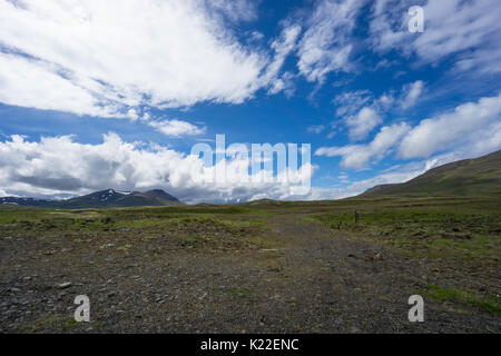 Iceland - Bright sunny day with some clouds in wide mountainous landscape - Stock Photo