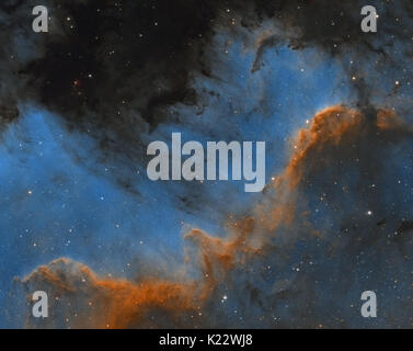 Cygnus Wall region of North America nebula in the constellation of Cygnus (The Swan) - Hubble Palette - Stock Photo
