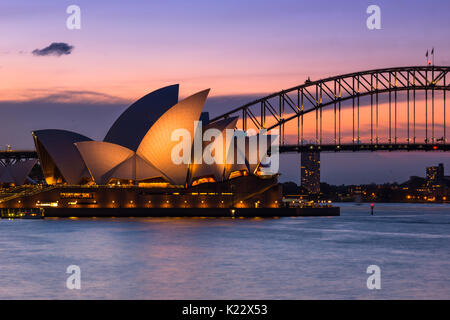 Sydney Opera House and Harbour bridge after sunset seen from Mrs Macquarie's Chair, Sydney, New South Wales, Australia - Stock Photo