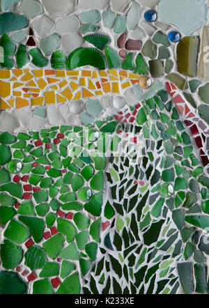 Close up of mixed media mosaic art work using sea glass, tile pieces and grout to make an abstract landscape portrait - Stock Photo