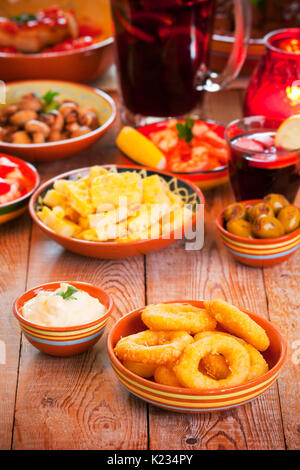 A table filled with all sorts of Spanish tapas and sangria. - Stock Photo