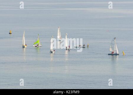 Lyme Regis, Dorset, UK. 28th Aug, 2017. UK Weather. People on sailing boats enjoying the hot sunshine on the water - Stock Photo