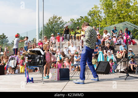 London, UK. 28th Aug, 2017. Childrens entertainment at the East London Waterways Festival held at the Queen Elizabeth - Stock Photo