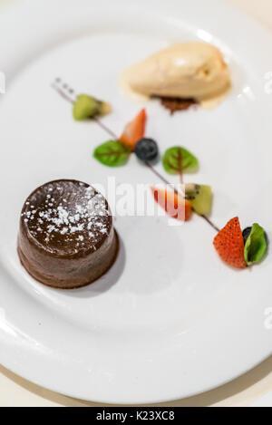 Chocolate Lava cake with Strawberry and Ice cream - Stock Photo